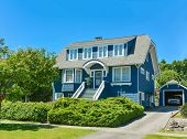 Big North American Family House With Detached Garage In Suburbs Of Vancouver. A House On Blue Sky Ba poster
