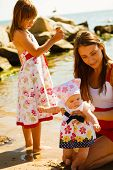Summertime Joy, Summer Recreation Outside Concept. Woman Holding Little Baby, Playing With Her Toddl poster