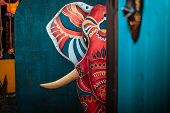 Painted Red Elephant. An Elephant Is Painted On The Wall. Red Indian Elephant poster