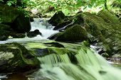 Long Exposure Of A Waterfall At Watersmeet In Devon poster