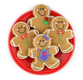 foto of gingerbread man  - Gingerbread cookies on a red plate isolated on white - JPG