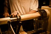 stock photo of woodcarving  - A woodcarver working on a piece of wood  - JPG