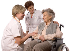 foto of health-care  - Health care workers and elderly woman in wheelchair - JPG