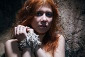 image of catacombs  - redheaded nude woman bondage in catacomb - JPG