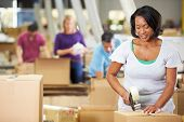 stock photo of dispatch  - Workers In Warehouse Preparing Goods For Dispatch - JPG