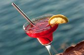 stock photo of cosmopolitan  - Cosmopolitan Cocktail with slice of lemon against sea - JPG