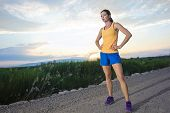 foto of breathing exercise  - In Shape female Runner at Sunrise - JPG