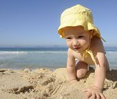 cute baby crawling on the beach
