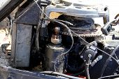 foto of outboard  - Old Disassembled Boat Outboard Motor on a sandy beach - JPG