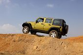 Green Jeep Wrangler Unlimited On 4X4 Course