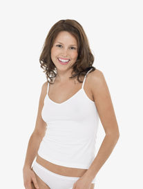 image of knickers  - Portrait of a young smiling woman in camisole and knickers against white background - JPG