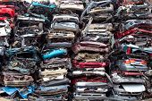 foto of junk-yard  - Stacked crushed cars going to be shredded in a recycling facility - JPG