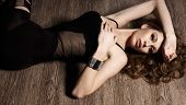 image of tights  - beautiful girl in black tights lying on the wood floor - JPG