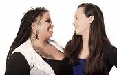 picture of dreadlocks  - Tattooed mother with dreadlocks and piercings with her daughter looking at each other happily on a white background - JPG