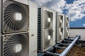 image of ventilator  - Air conditioning system assembled on side of a building - JPG