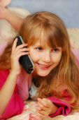 picture of goodnight  - young girl talking by phone on the bed - JPG