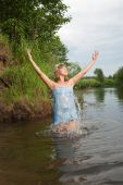 image of undine  - Jumping girl in flower chaplet at river - JPG
