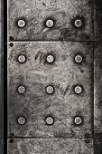 picture of stelles  - Black grunge metal plate texture with rivets as background - JPG