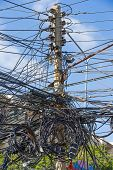 picture of utility pole  - electric pole with messy wire that look dangerous - JPG