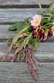 pic of dog-rose  - Bouquet of dog roses, honey suckle and wild grasses , tied and laid On my way! vintage wooden bench ** Note: Shallow depth of field - JPG