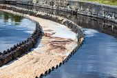 stock photo of sewage  - Sewage water overflowing from round settlers - JPG
