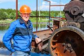 pic of sewage  - Engineer worker standing near sewage treatment mechanism - JPG