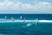 stock photo of windy  - Windsurfers in windy weather on Maui Island