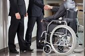 foto of disability  - Handshake between disabled man and boss in office - JPG