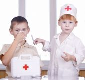 stock photo of health-care  - Small children play hospital and doctor on white  - JPG