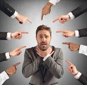 picture of insults  - Businessman accused and insulted by his team - JPG