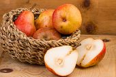 stock photo of wooden basket  - Ripe Pears in Basket over wooden background