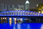 foto of singapore night  - famous Anderson bridge built in 1910 and Singapore skyline with scenic night illumination - JPG