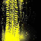 picture of skid  - Yellow grunge tire track with ink blots and halftone - JPG