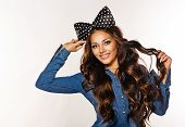 picture of hair bow  - Photo of a beautiful girl with long hair and a bow on her head - JPG