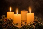 stock photo of mood  - an advent wreath for christmas ensures romatinsche mood in the silent advent - JPG