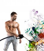 stock photo of fuel pump  - Sexy man with fuel pump and colorful effect - JPG
