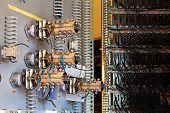 stock photo of contactor  - The old ceramic fuses on the control panel