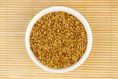 stock photo of flaxseeds  - Aerial top view of golden flaxseed on wood background - JPG