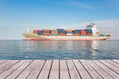 image of ship  - Cargo ship and cargo container in sea with clear sky background - JPG