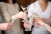 pic of congrats  - Woman hands with glasses of martini close - JPG
