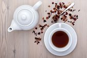 stock photo of teapot  - cup of tea with teapot and spices on the table - JPG