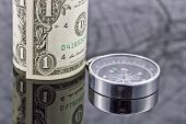 foto of reflection  - dollar bill and compass are on the surface which reflects map - JPG