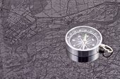 stock photo of reflection  - the compass on the background of the reflection maps - JPG