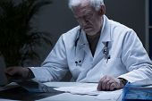 picture of ward  - Head of hospital ward reading medical records - JPG