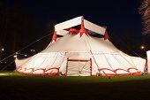 picture of circus tent  - Big top circus tent illuminated at night - JPG