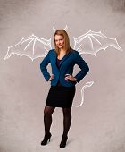 foto of nasty  - Young nasty girl with devil horns and wings drawing - JPG