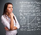 foto of mathematics  - Beautiful young school girl thinking about complex mathematical signs - JPG
