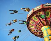 stock photo of carnival ride  -  Swing ride at fair spinning around with people having fun  - JPG