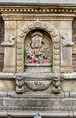 picture of pooja  - A carving of a Hindu god  at a shrine in Bhaktapur - JPG
