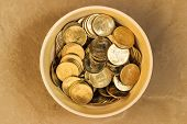 pic of indian currency  - Indian coins saved in a bowl on a plain background - JPG